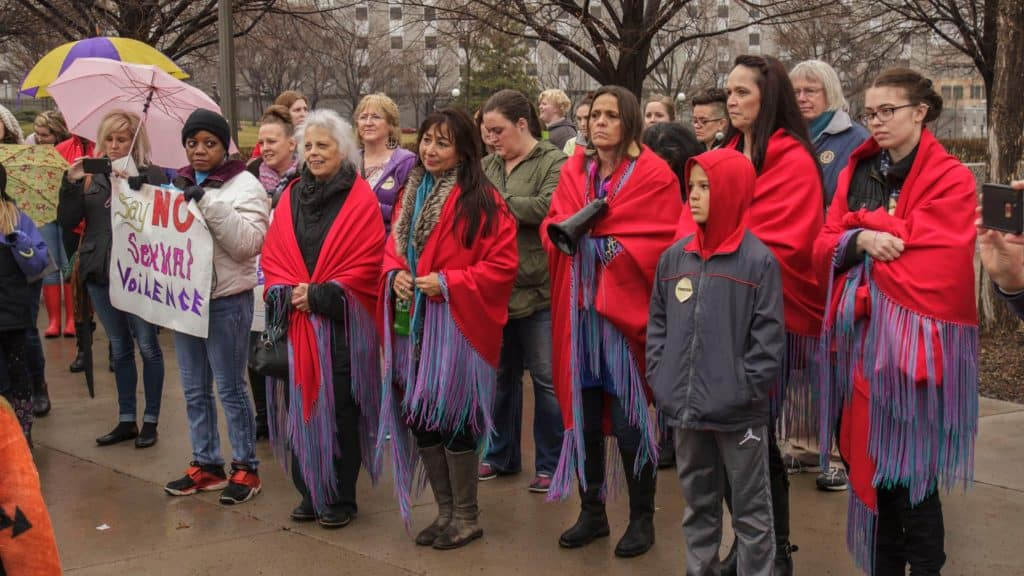 Group of people wearing red shawls